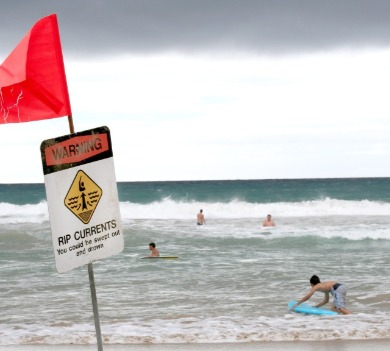 rip current sign on the beach | SeaShore Realty