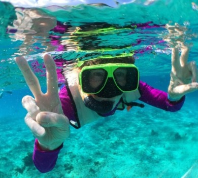 girl snorkeling in the ocean | SeaShore Realty