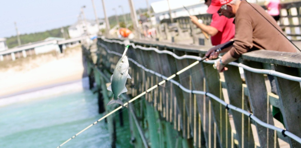 men catching fish off the Jolly Roger Pier in Topsail Beach | SeaShore Realty