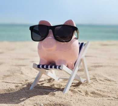piggy bank sitting on the beach | SeaShore Realty