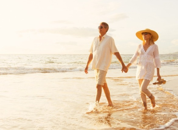 couple walking on the beach | SeaShore Realty