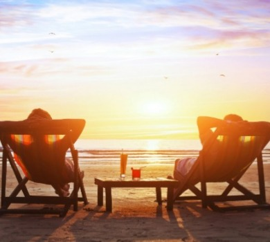 two people enjoying Topsail Island sunset on the beach | SeaShore Realty