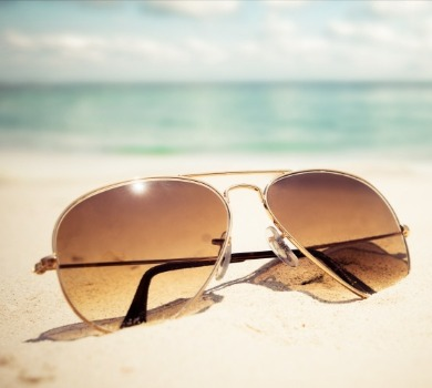 sunglasses on the beach | SeaShore Realty