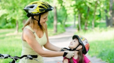 mother putting helmet on daughter | SeaShore Realty