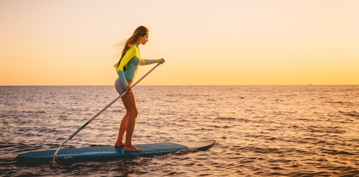paddle boarding on topsail beach | SeaShore Realty